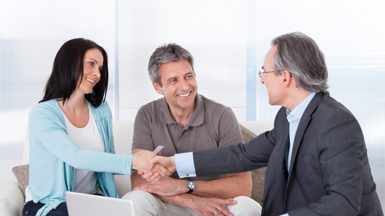 Portrait Of Mature Consultant Shaking Hand With Happy Woman